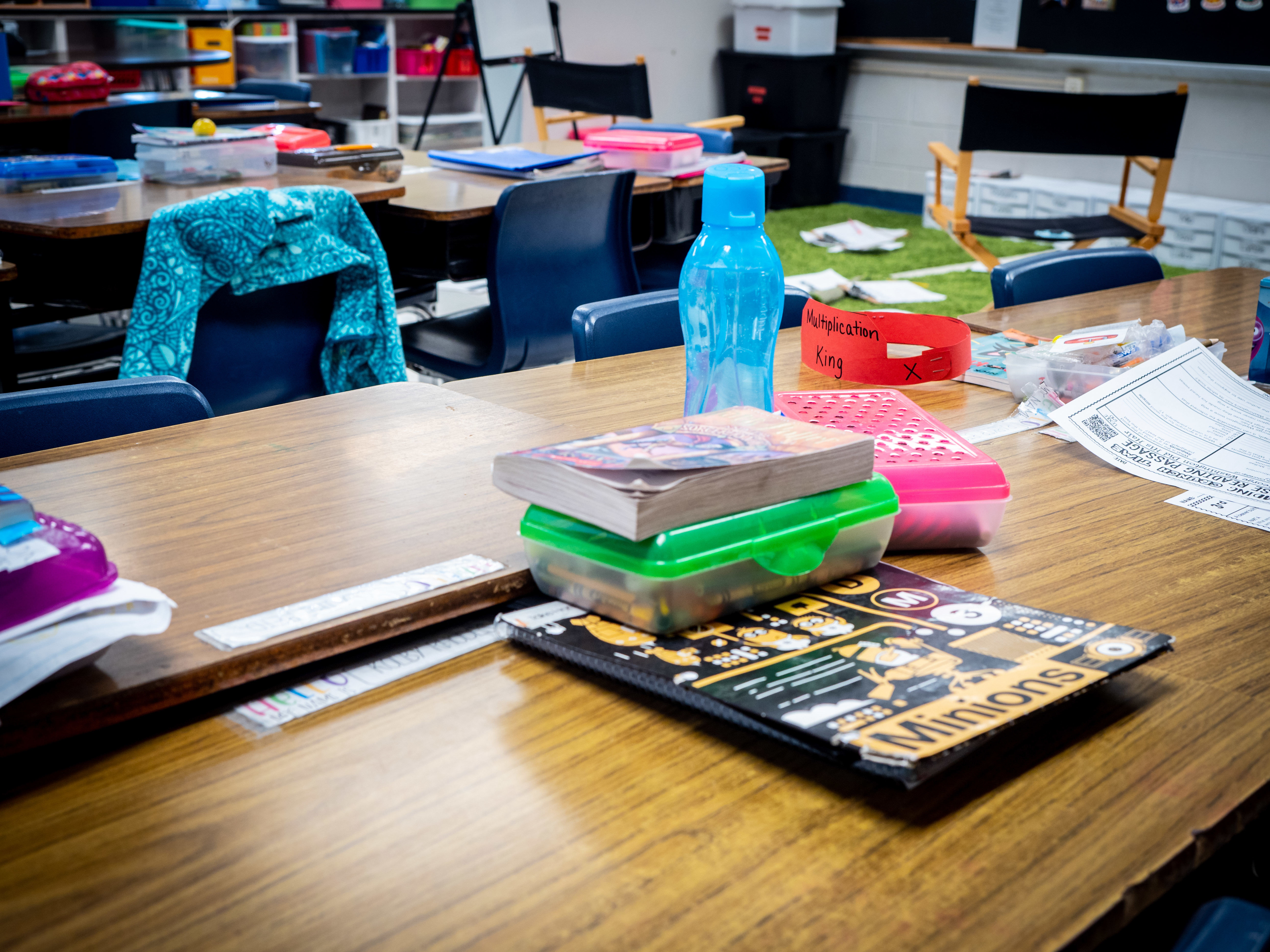 Image of student desks with school materials