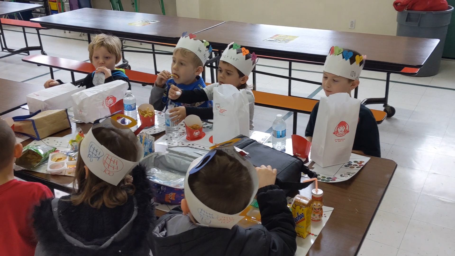 Students having lunch on 100th Day of school at Madison Park